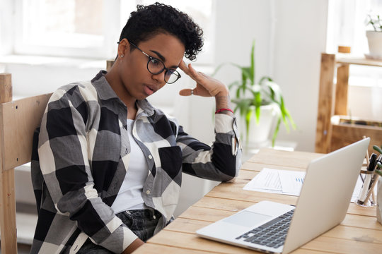 Bored african american woman tired from computer work or study