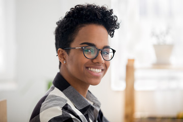 Headshot of happy african american girl looking at camera