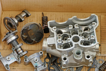Damaged Motorcycle Engine Parts in a Box