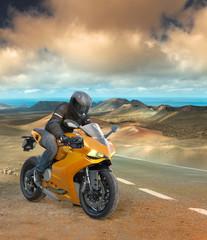Biker on a volcanic landscape