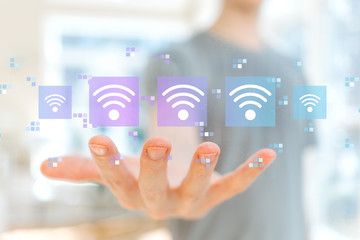 Wifi concept with young man holding his hand