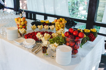 A meal decorated with different fruits at a feast.