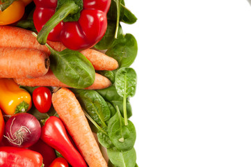 Vibrant array of fresh vegetables on a white background with room for text