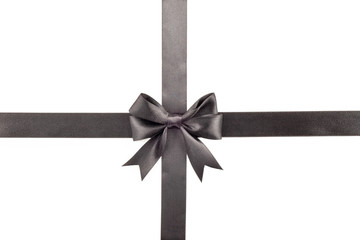 Black bow with ribbon on white background
