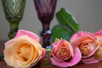 bouquet of roses with groceries on the table