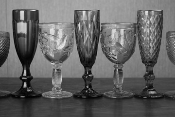 glasses in a row for alcoholic drinks black and white photo