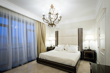 The apartment in classical style, wooden furniture, marble, luxury.