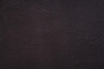 Old t-shirt texture, dark blue stretch fabric background. Analog photo simulation