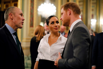 Britain's Prince Harry and Meghan, Duchess of Sussex, attend the Endeavour Fund Awards in the Drapers' Hall in London