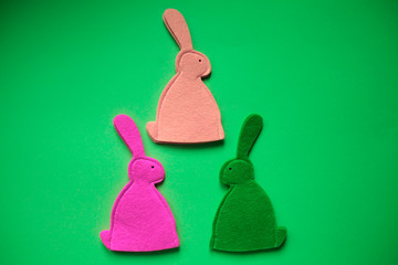 Easter bunnies on the green background.