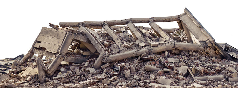 Collapsed and destroyed concrete industrial building isolated on white background. Disaster scene full of debris, dust and damaged house