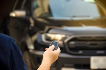 Hand press remote car.Concept finance.Car business concept.