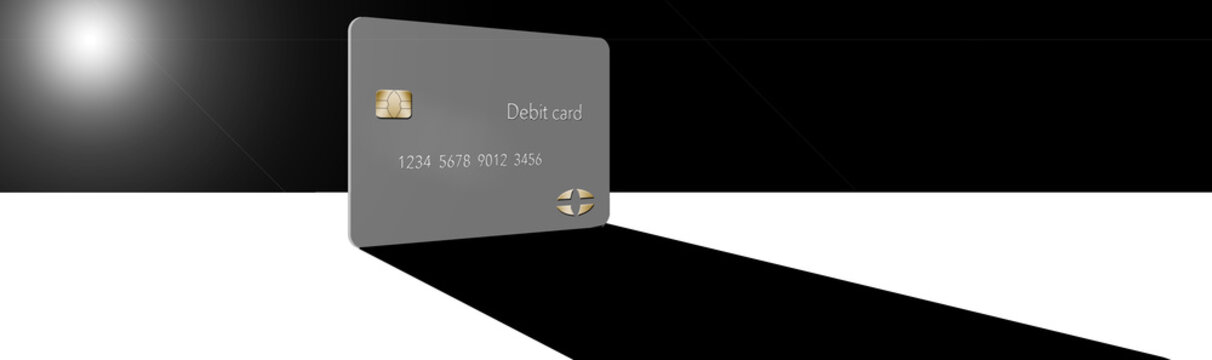 A debit card casts a shadow in this minimalist image with limited color mixed with grey, blacks and whites.