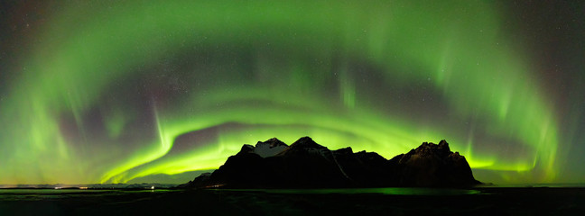 Aluminium Prints Northern lights Panoramic of the Northern Lights over Vestrahorn Mountain at Stokksnes peninsula in Southeast Iceland