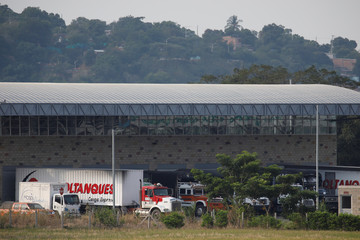 Trucks are seen at a warehouse, where international humanitarian aid for Venezuela will be stored according to authorities, near the Tienditas cross-border bridge between Colombia and Venezuela, in Cucuta
