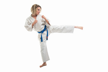 Female wearing martial arts uniform making karate move