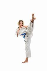 Female wearing martial arts uniform making karate move