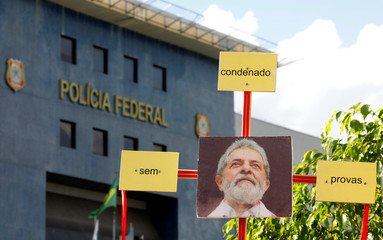A picture of Brazil's former President Luiz Inacio Lula da Silva is seen outside the Federal Police headquarters where Lula is serving a prison sentence, in Curitiba