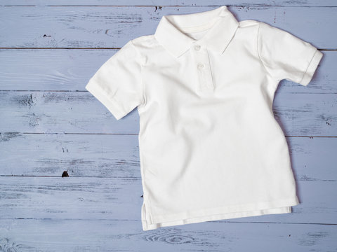 White cotton pique polo classic look for kids child baby. Fashion, shopping concept. Template for online store, Flat lay, top view from above