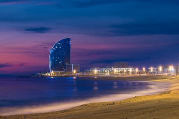 Barcelona Beach in summer night along seaside in Barcelona, Spain. Mediterranean Sea in Spain.