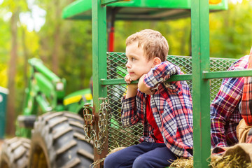 boy riding a tractor on a farm. Hayride. Copy space for your text Wall mural