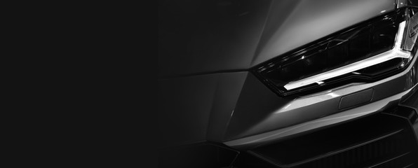 Wall Mural - Detail on one of the LED headlights super car.copy space