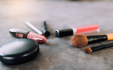 Makeup brushes and tools on desk.