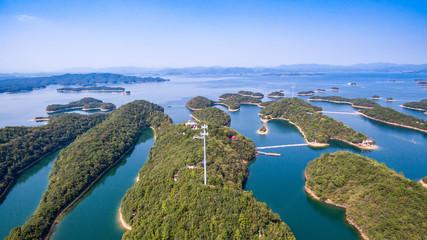 Thousand Island Lake(famous Hangzhou tourist attraction) with green mountains under blue clouds sky in zhejiang, CHIAN