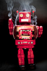 mad  red robot on fire with smoke