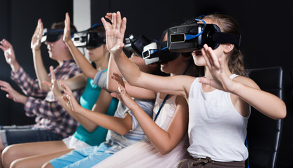 Girl watching the video with family in virtual reality room