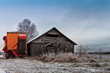Potato Harvester By An Old Barn