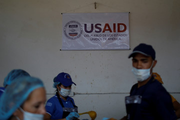 The logo of USAID is seen at a community kitchen set-up by them and the World Food Programme in Cucuta