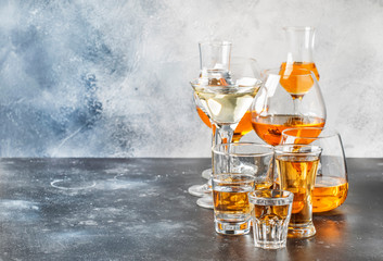 Spoed Foto op Canvas Alcohol Selection of hard strong alcoholic drinks in big glasses and small shot glass in assortent: vodka, rum, cognac, tequila, brandy and whiskey, grappa, liqueur, vermouth, tincture, rum.