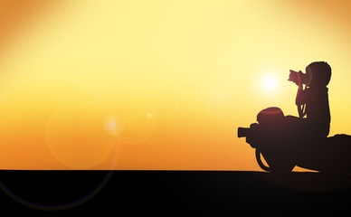 Silhouette of dad and son looking at camera lenses on sunset background