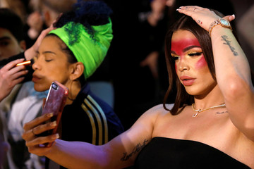 Transgender model Jessica Cortez checks herself in her phone before walking at the CHULO underwear show during the New York Fashion Week, which raised money for transgender and cisgender young women victims of violence, in New York