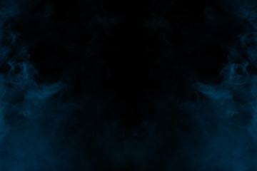 mysterious clouds of blue cigarette vapor on a dark background