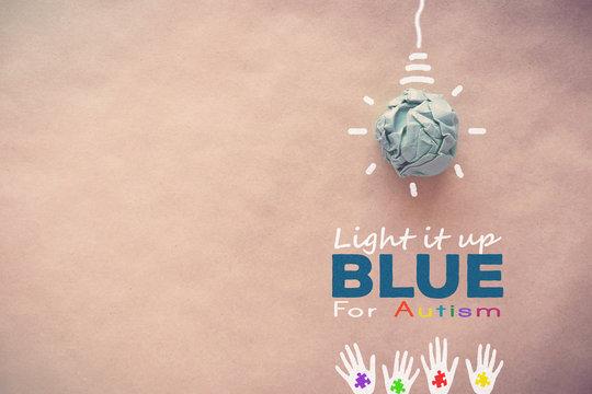 Blue paper light bulb , world Autism awareness day