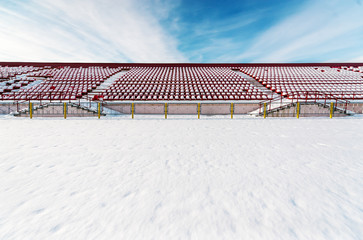 Chairs at stadium, covered with snow in winter