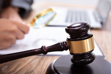 Mallet In Front Of A Judge Analyzing The Invoice