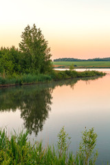 Nature and landscape of Russia. Journey through the Saratov region, the Volga region. Early morning, dawn on the lake in good summer sunny weather.