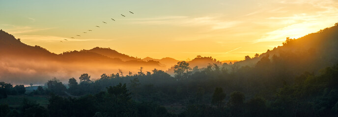 Panoramic view of forest and mountains, summer landscape with foggy hills at sunrise near coast Ngapali, Burma.