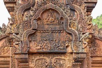 wonderful carvings in the kudu-arch at the temple.Banteay Srei temple, Siem Reap, Cambodia, Asia
