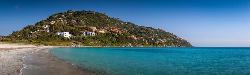Villas on hill near crystal clear mediterranean sea. Sardinia, Italy