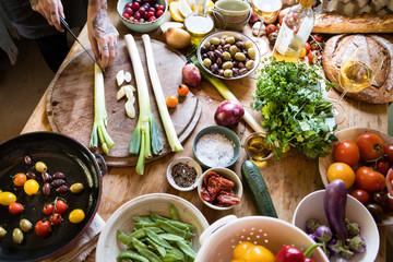 Vegetable ingredients being prepared for cooking