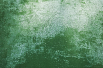 Green peeling wall. White and green wooden background.
