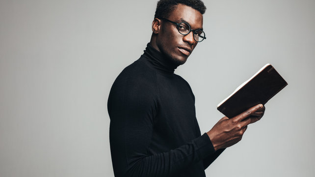 Smart young man with a book