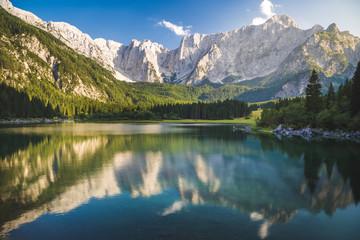 Wall Mural - Superior Fusine Lake with Mount Mangart on the background. Fusine Lakes Natural Park, Tarvisio, Udine province, Friuli Venezia Giulia, Italy.