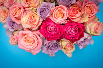 Beautiful bouquet of roses in a gift box. Bouquet of pink roses. Pink roses close-up. on blue background, with space for text.