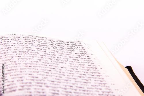 Opened hebrew Bible, isolated on white background