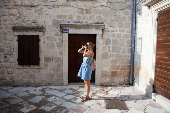 Woman tourist walks through the streets of the old town of Kotor in Montenegro
